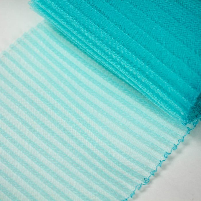 Light Turquoise polyester, very flexible, 1/4 inch pleats.
