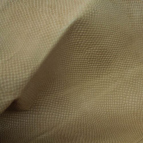 Golden Tan Embossed Reptile Pattern. Supple and soft leather, thickness of .70mm-.80mm, and blockable. Dyed all the way through.
