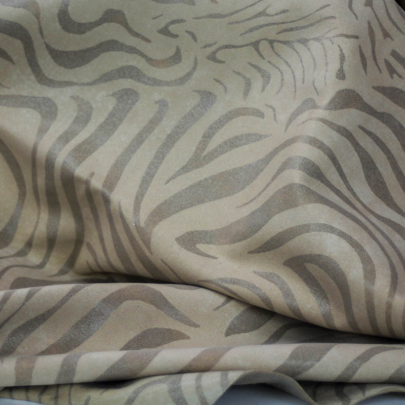 4 sq ft. Supple and soft leather, thickness of .50-.60mm, and blocking. Dyed all the way through