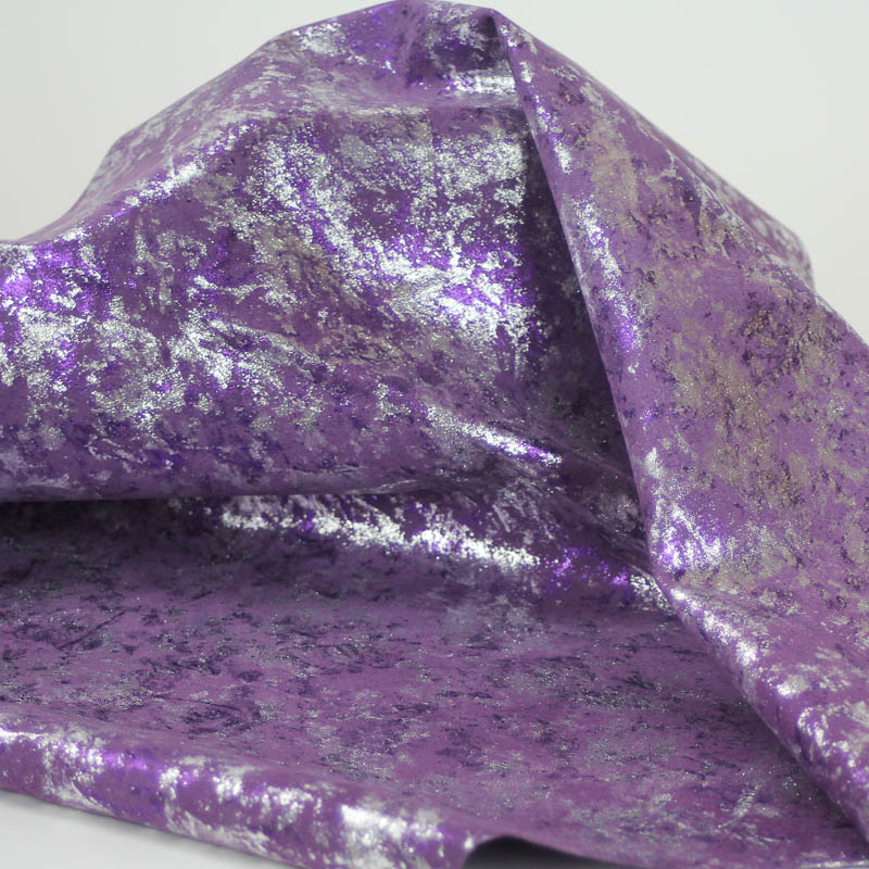 Purple and Silver mix pattern on pig suede. Supple and soft leather, thickness of .50-.55mm, and blockable.