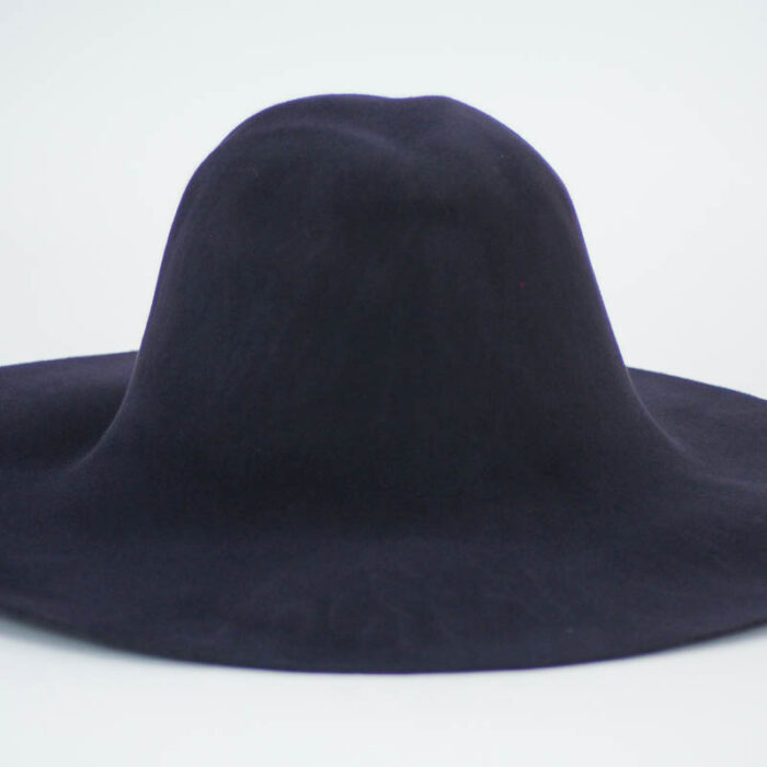 Deep navy capeline with suede finish.