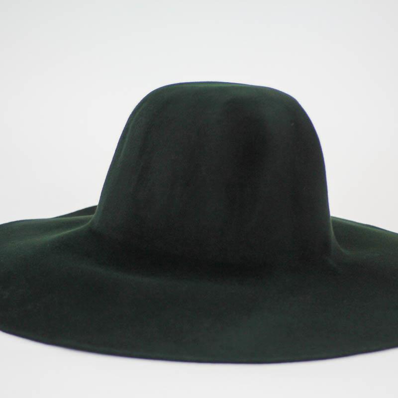 Deep green suede capeline.