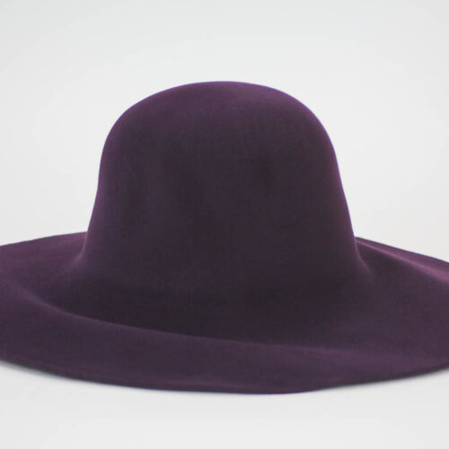 Rich looking aubergine suede capeline.