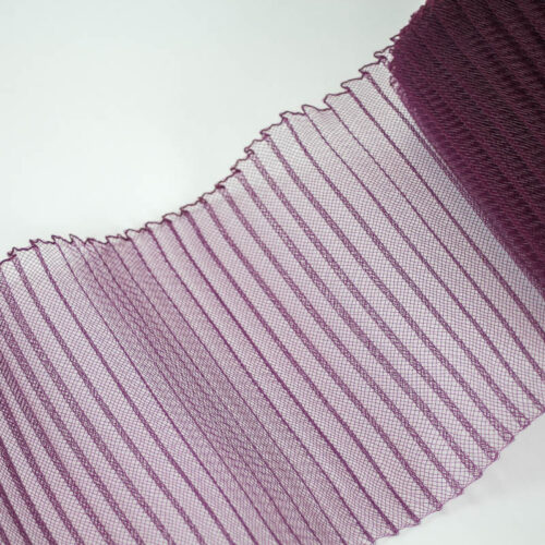 Plum polyester, very flexible, 1/4 inch pleats.