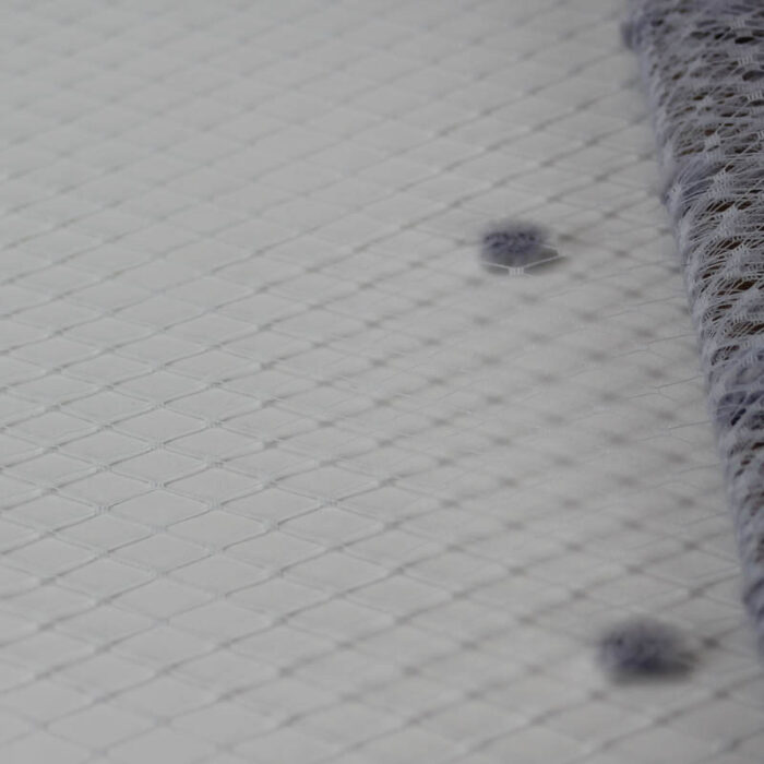 Periwinkle Standard diamond pattern with 1/4 inch opening, 8-9 inch width and 1/4 inch chenille dots, 100% nylon.
