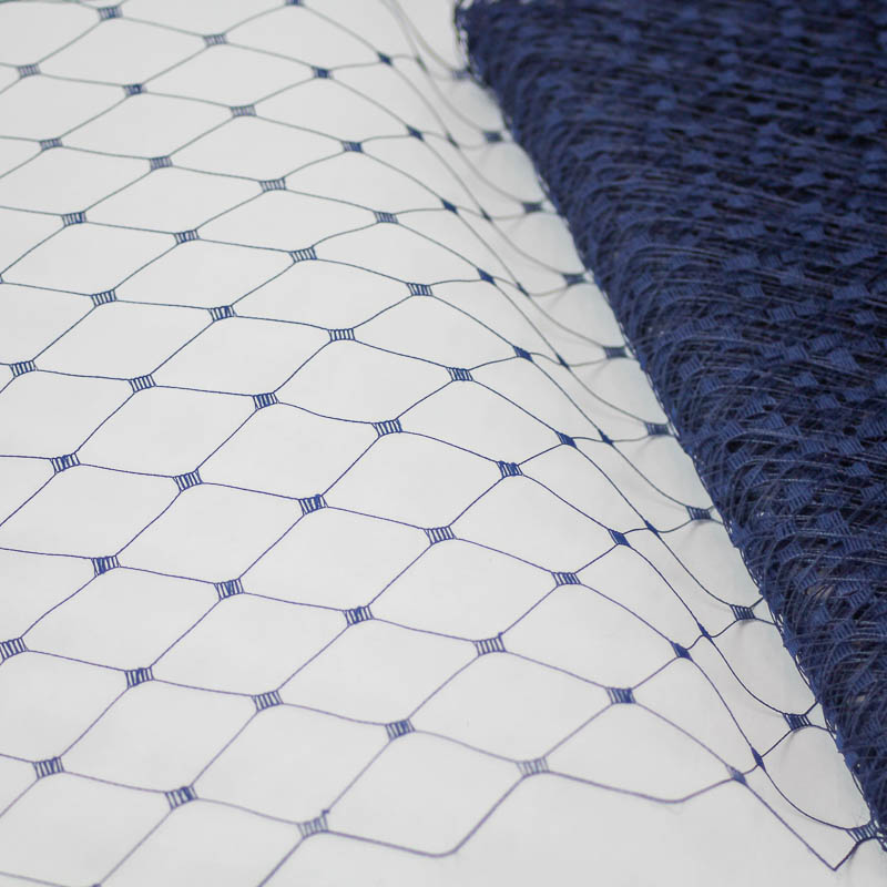 """Navy This 12"""" Hat Veiling, one-inch open diamond pattern. The large open pattern gives it a vintage look. 100% Nylon."""