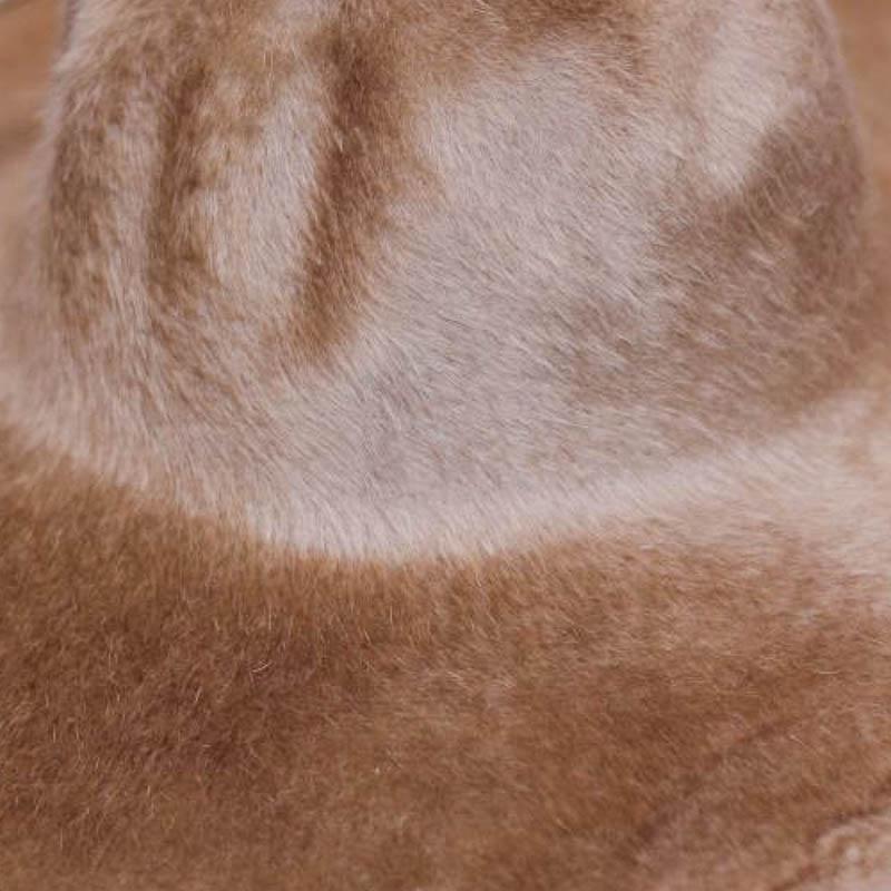 A sandy tan. Brims are size 16/17 inch brim width (113 grams).