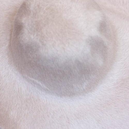 A light alabaster beige. Brims are size 16/17 inch brim width (113 grams).