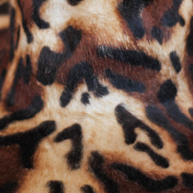 Camel with ginger, dark brown and black spots. 15/16 diameter.