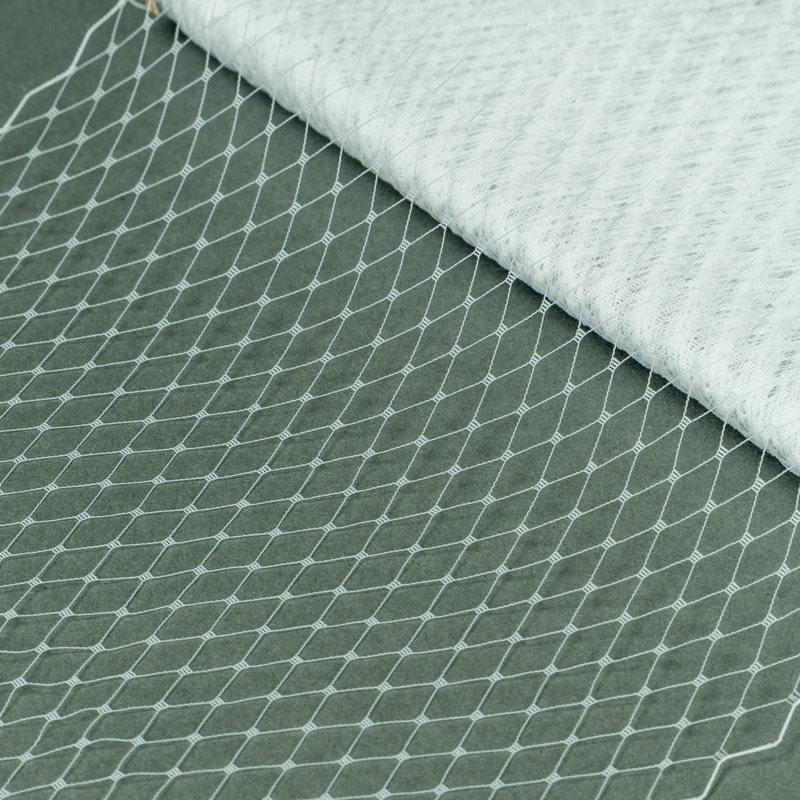 White Standard diamond pattern with 1/4 inch opening, 100% nylon. Also called Russian veiling. Made in Taiwan.