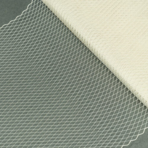 Ivory This fine 100% nylon veiling has a vintage feel,