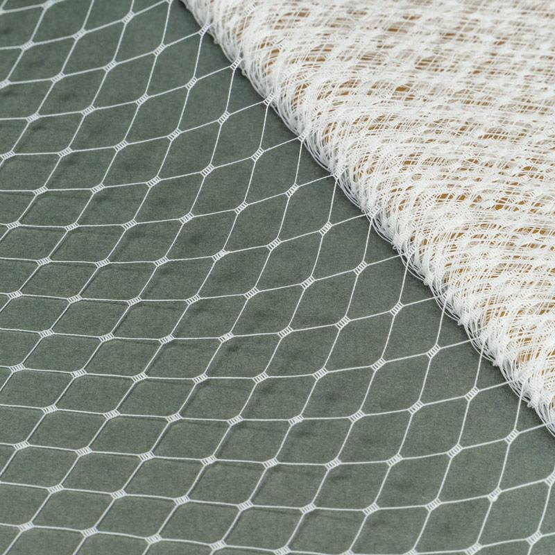 White Merry Widow pattern with 1/2 inch diamond opening, 12 inch width, 100% nylon.
