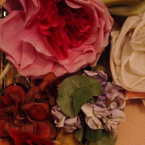 In depth tutorial on the art of handmade silk roses and gardenias.