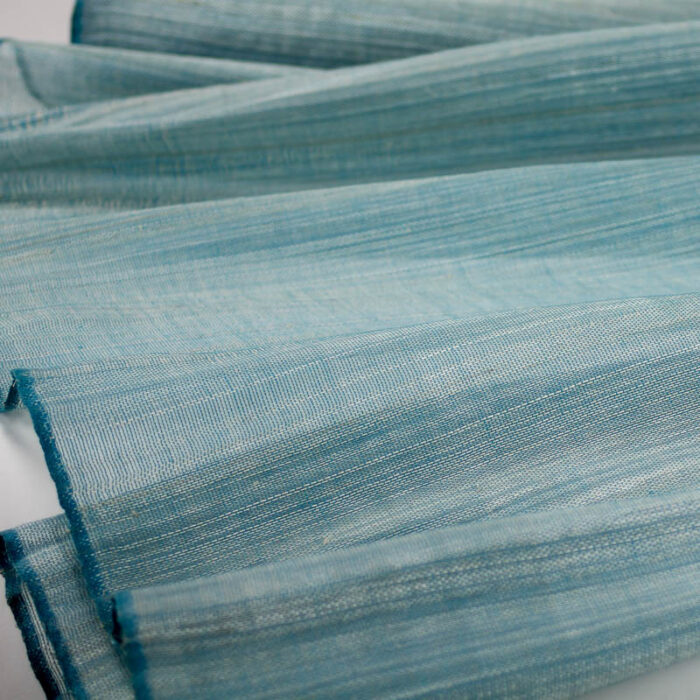 Teal/Turquoise Abaca woven with polyester thread.