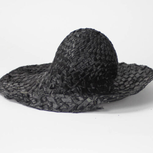 Vintage black color hatbody in woven cellophane or onionskin straw. Brim is 4' width. The body can be blocked. There is some break down in the fiber. Okay quality.