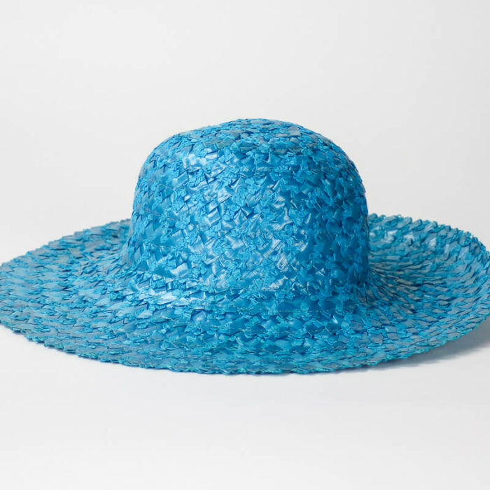 Vintage bright turquoise color in woven cellophane or onionskin straw. The edge of the brim has been wired but the crown can be blocked. There is no sweatband so I don't think this was ever worn as a hat.